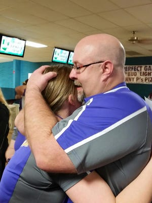 Lexington senior Megann Hardman shares a hug with her dad Jim after learning she had qualified for the state bowling tournament.