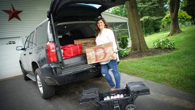 Pam Dimichele, started Crimson Pallets, an in-home or in-office painting pallet signs party company after she needed something to do when her last child was old enough to go to school. She runs the business out of her vehicle.