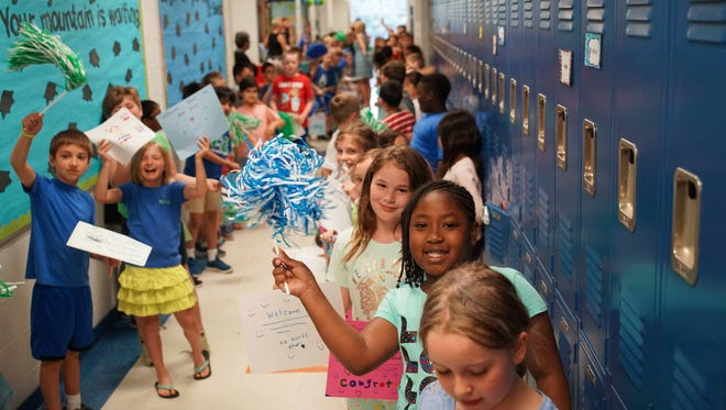 The first class of kindergarteners from North Star Elementary School, that opened in 2005, are graduating from high school this year. They returned to the school on Thursday to parade through the halls while current students cheered them on.