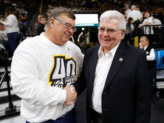 Mike Street, left, talks with former Iowa head basketball coach Tom Davis before an NCAA college basketball game between Iowa and Purdue, Saturday, Jan. 20, 2018, in Iowa City, Iowa. Street's son Chris, who played for Davis at Iowa, was killed in a collision with a snow plow on Jan. 19, 1993, in Iowa City. (AP Photo/Charlie Neibergall)