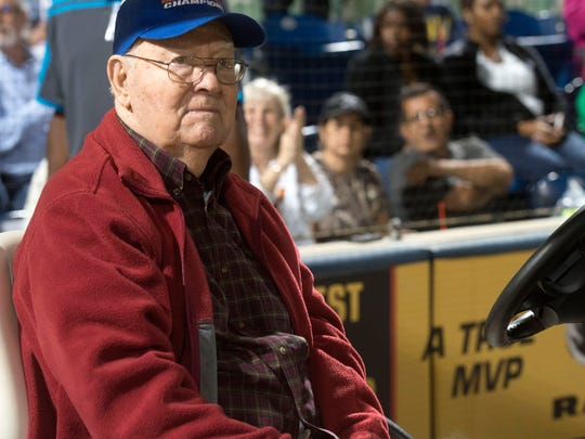Bill Bond watches as young baseball players, coaches, and parents parade past him on March 10 during the kick-off the 50th anniversary of Bill Bond Youth Baseball. 30 teams with players ranging in age from 6-14 took part in the event at Blue Wahoos Stadium.