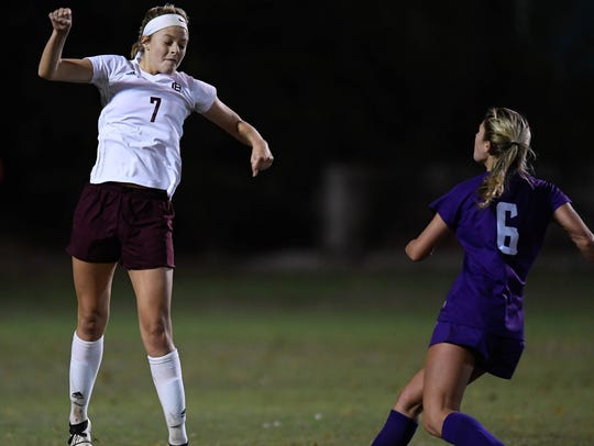 Henderson's Carlee Crafton (7) heads the ball in front