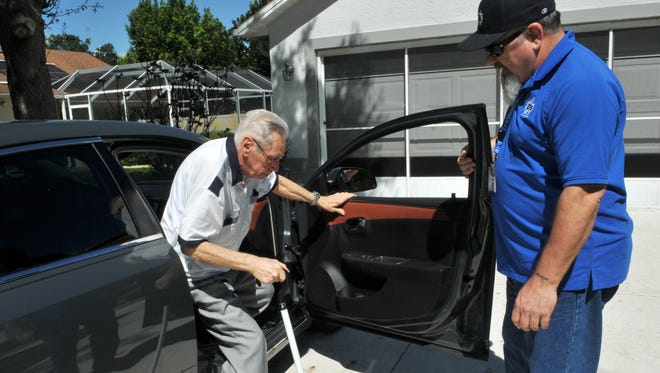 Veteran Warren Weld, right, holds the car door open for John Vollario, 88, who served in the Navy in World War II. Weld volunteers to drive aging or disabled veterans to medical appointments in Brevard County, Fla.