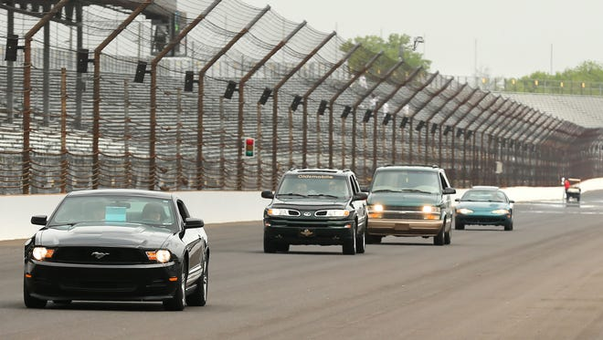 A chance to drive personal cars around the track remains part of Community Day.