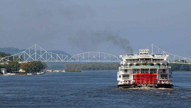 3. In sight of the Blackhawk Bridge connecting Lansing, Iowa, with Wisconsin, the American Queen paddle-wheeler heads up the Mississippi River.