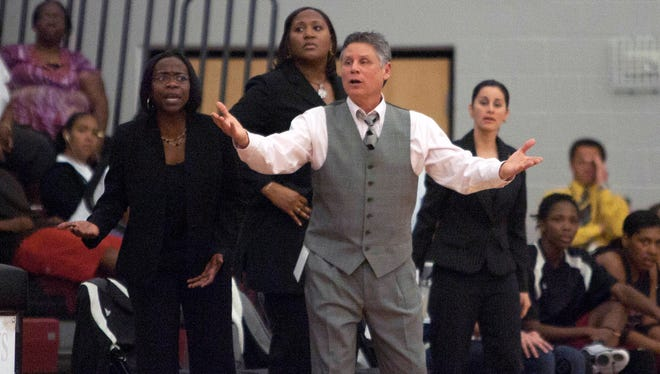 Ursula Norris, left, assistant women's basketball coach at Florida Tech, was ordained as a reverend in September.
