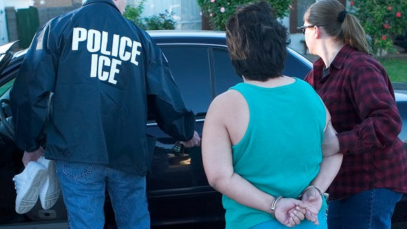 ICE officers arrest a convicted felon at her Mesa home
