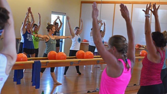 Kennen Barber-Ensz, Barre3 Sioux Falls studio owner, leads a Barre3 class Friday, July 8, 2016, in Sioux Falls.