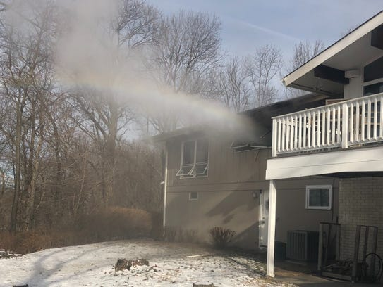 Two firefighters were injured and a cat is missing