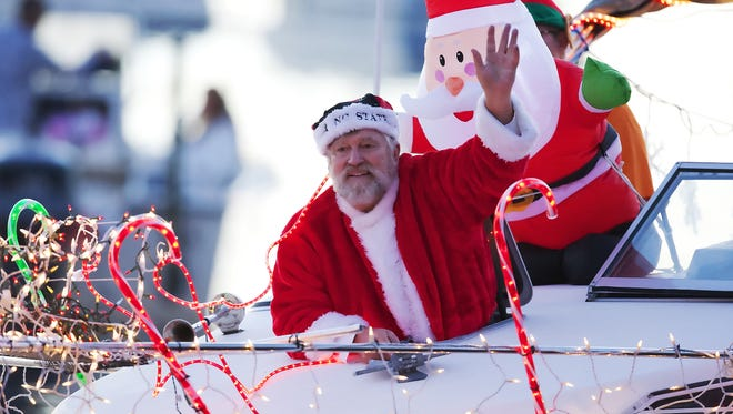 Brighten your spirits at Saturday's Naples Bay Christmas Boat parade or at the Village on Venetian Bay's lighted boat parade next Tuesday.