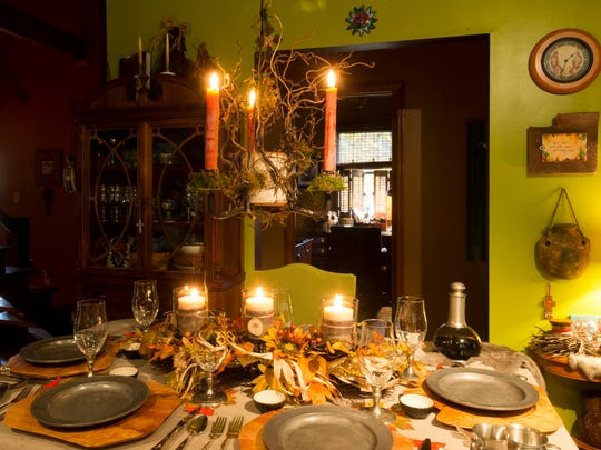 Harvest colors and candles set the tone for the family's Thanksgiving dinner at Jenna Jefferson and Keith Ford's home near Harrogate, Tennessee.