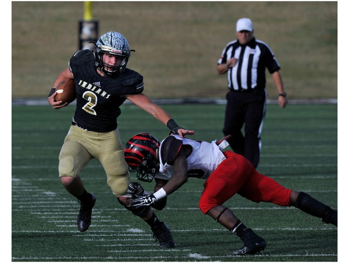 Comanche High School running back Colton Roberts slips