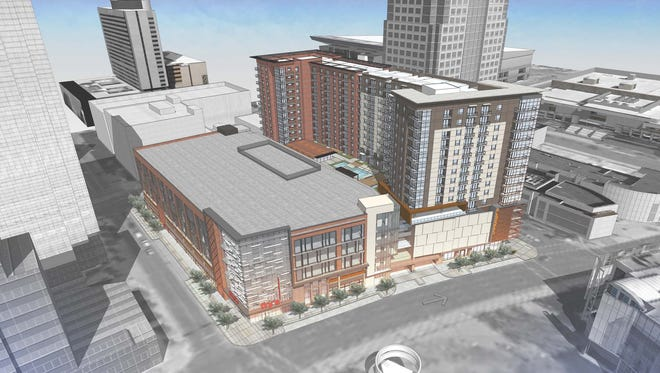 """An artist's rendering shows a project proposed by RED Development that would include an """"urban"""" Fry's grocery store as part of a high-rise apartment, office and retail project."""