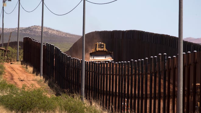 Work continues on the border wall replacement project in Naco, Arizona, on May 12, 2017.