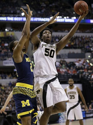 Purdue Boilermakers forward Caleb Swanigan (50) puts up a shot around Michigan Wolverines guard Zak Irvin (21) in the first half of their Big Ten Men's Basketball Tournament semifinal game Saturday, Mar 12, 2016, afternoon at Bankers Life Fieldhouse.