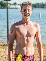 Harper Creek Junior Ethan Wilson is the 1st place male finisher for the 90th Annual Goguac Lake Swim on Saturday.