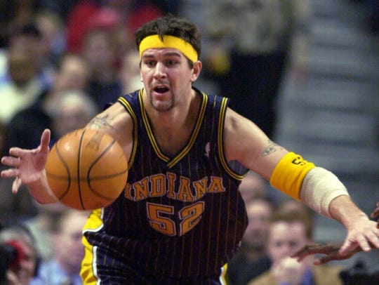 Indiana Pacers' Brad Miller (55) tries for a loose