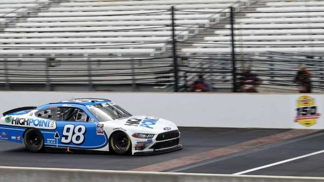 (Chris Graythen photo) Chase Brisco crosses the brick first in Indy's Xfinity Series race on the Indy road course