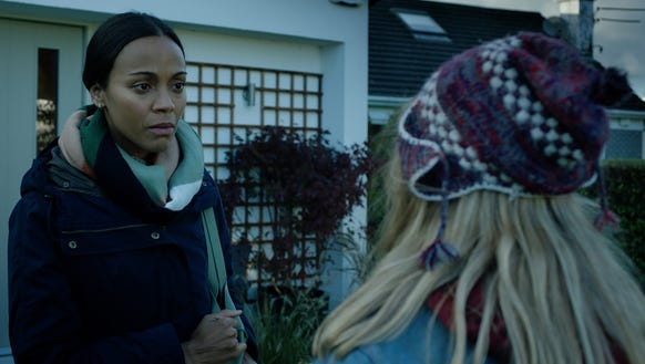 Mrs. Molle (left, Zoe Saldana) tries to help out a