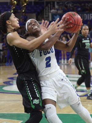 FGCU's Kaneisha Atwater colides with Stetson's DeAsia Beal during the Atlantic Sun Conference Women's Basketball Tournament semifinals at Alico Arena on Wednesday