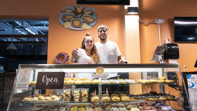 Doughnut Homies owners Hayleigh Noel and Christian Velazquez at their shop in the Worcester Public Market at Kelley Square.