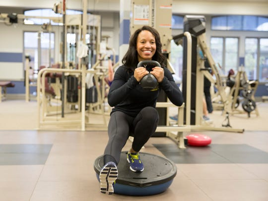 Director of Fitness Dextria Sapp works out at the City