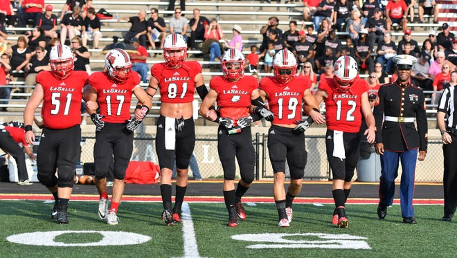 The LaSalle Lancer captains Andrew Jaeger, Zach Rumpke, Josh Whyle, Sam Hildebrand, Brody Ingle and Griffin Merritt take the field against Colerain at the Skyline Chili Crosstown Showdown, Friday, August 25th at LaSalle High School