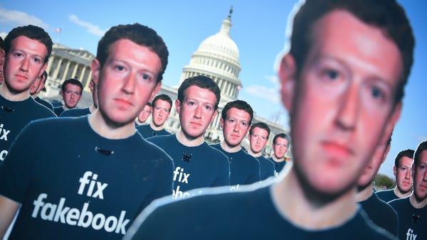 100 cutout figures of Facebook CEO Mark Zuckerberg