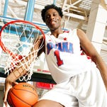 In this April 3, 2015 photo, Caleb Swanigan from Homestead High School poses in Indianapolis. Caleb Swanigan of Class 4A state champion Fort Wayne Homestead has been named this year's Mr. Basketball. (AP Photo/The Indianapolis Star, David Dixon) NO SALES