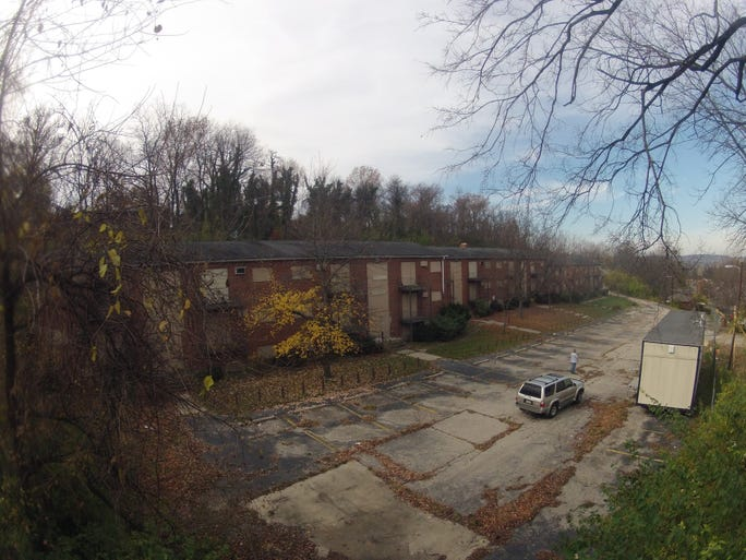 Before being transformed into the Alston Park apartment community, these abandoned buildings on Glenwood Avenue in Avondale were eyesores.
