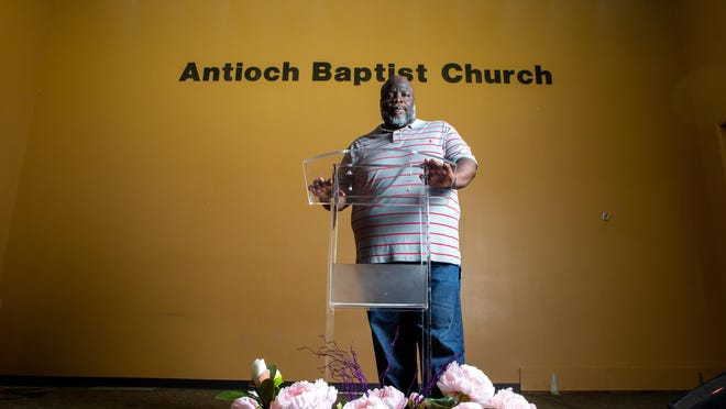 Rev. T.D. Hicks, pastor of Antioch Missionary Baptist Church, stands for the first time since March at the pew of his church Friday morning. Following a stroke,  being released during the COVID-19 pandemic and watching events unfold following the death of George Floyde, Hicks decided to take a break from his duties until September.