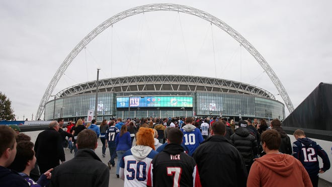 Fans make their way to Wembley Stadium prior to a game between the Detroit Lions and Atlanta Falcons Oct. 26, 2014, in London.