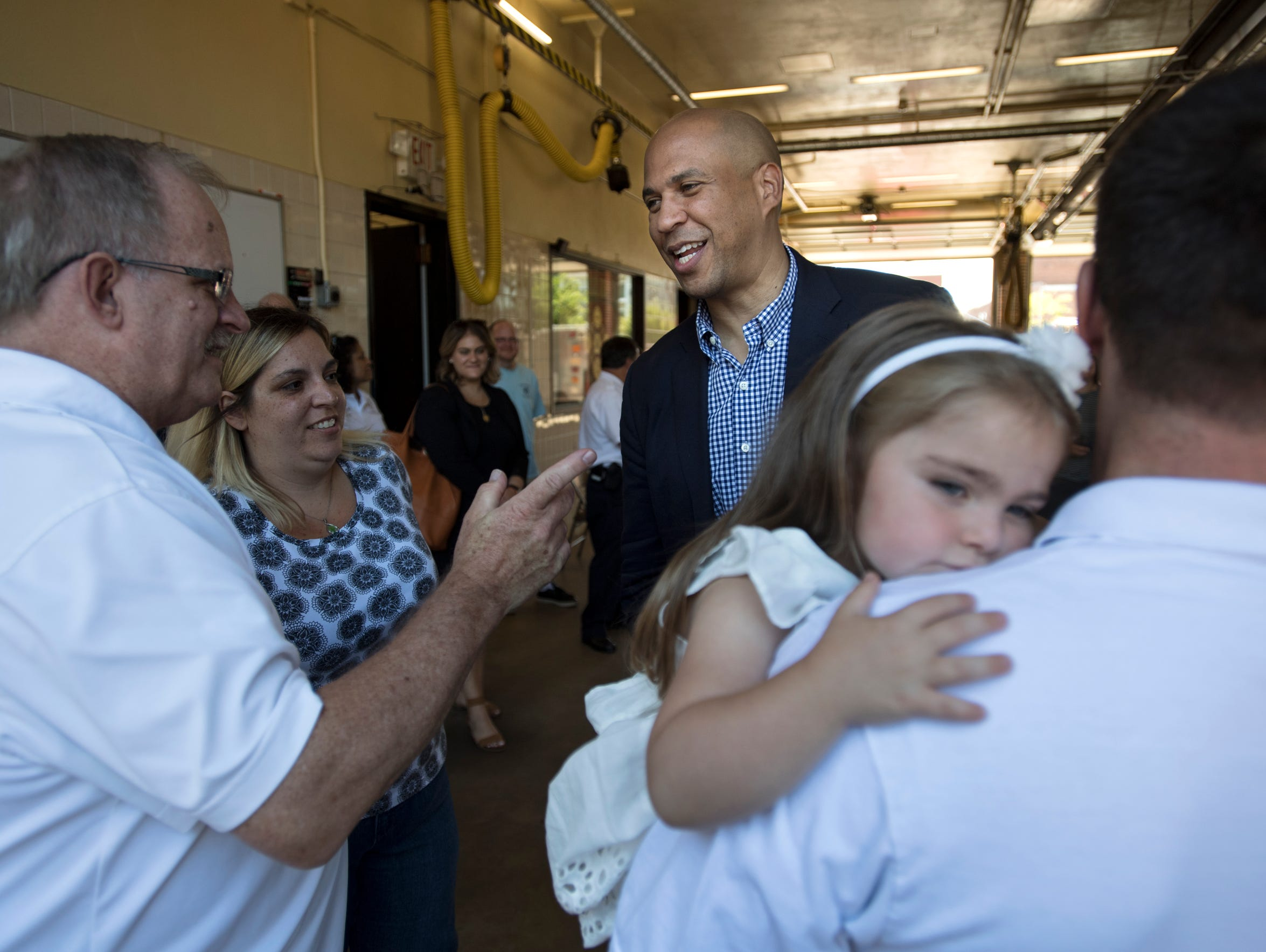 Senator Cory Booker talks with supporters at the Somerville