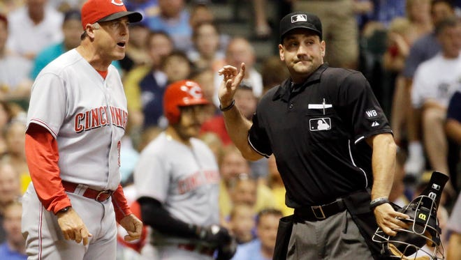 Umpire David Rackley ejects Reds manager Bryan Price during the sixth inning Monday at Miller Park.