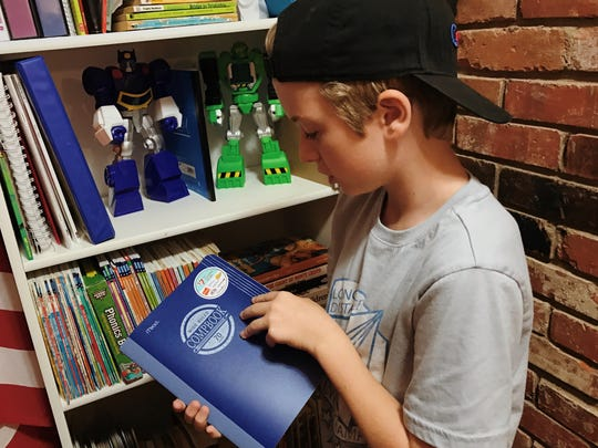 Truett Mullins keeps his school supplies in a bookshelf