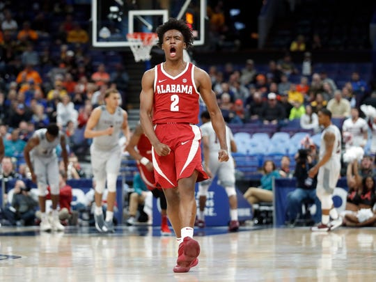 Alabama's Collin Sexton celebrates after a teammate's basket during the second half in an NCAA college basketball game against Texas A&M at the Southeastern Conference tournament Thursday, March 8, 2018, in St. Louis. Alabama won 71-70. (AP Photo/Jeff Roberson)
