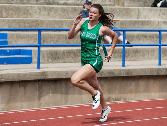 Wall's Sawyer Lloyd races in the 800 meter relay during