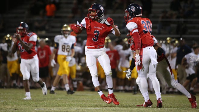 Centennial's Jaydin Young (3) reacts after intercepting a pass against St. Thomas Aquinas in the first half at Centennial High School in Peoria, Ariz. on Sept 29, 2017.