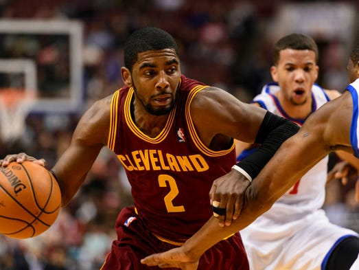 Cleveland Cavaliers guard Kyrie Irving (2) is defended by Philadelphia 76ers forward Thaddeus Young (21) during the first quarter at the Wells Fargo Center.