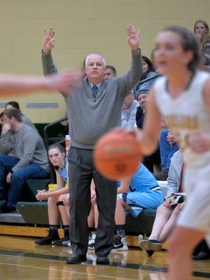 Great Falls High coach Jerry Schmitz calls out a play during last week's crosstown girls' basketball game at CMR Fieldhouse.