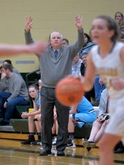 Great Falls High coach Jerry Schmitz calls out a play during one of last year's crosstown basketball games in the CMR Fieldhouse.