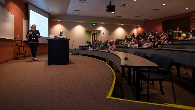 Doctoral student Rebecca Pruitt talks to NMSU students about her research in self compassion and life satisfaction for Latinos. Pruitt's talk was one of five doctoral student presentations that included the work of Kayla Boland, Steve Pereira, Alejandro Cervantes and Wiley Stem.