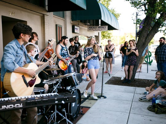 Members of RiverCity Rock Star Academy's Royals perform outside Ranch Records for Make Music Day in Downtown Salem on June 21, 2017. Make Music Day is a global celebration of making music that takes place every year on June 21.