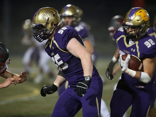 North Kitsap's Ryan Brooks (56) was a key member of the Vikings' dominant offensive line, but he may have had an even bigger impact on defense.