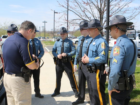 Delaware State Police Sgt. Tony Mendez gives parting instructions to (from left) Cpl. Michael Morgan, Cpl. Chris Garcia, Cpl. Mike Fezza, Trooper Kyle Marvel, Sgt. Richard Bratz and Cpl. James Smith, who all were a part of a distracted driving operation Thursday in Kent County.