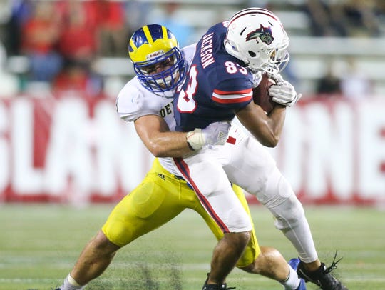 Delaware linebacker Troy Reeder drags down Stony Brook's Harrison Jackson in the fourth quarter of the Blue Hens' 24-20 win at Lavalle Stadium last year.