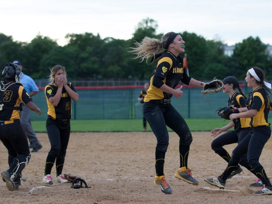 St John Vianney celebrate as they win in the ninth inning. St John Viianney defeats Ocean in extra innings for Shore Conference Tournament Softball Title.