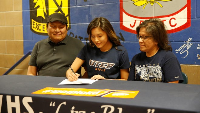 Piedra Vista's Josephine John signs her national letter of intent on Wednesday to join University of Texas at El Paso's women's rifle program.