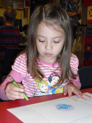 Makayla Damico draws a picture on the first day of preschool at the Colt Early Childhood Education Center in this State Journal file photo.