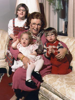 Gertrude Barber, founder of the Barber National Institute, loved the company of children. Shown here in this undated photo from the Barber National Institute are, from left, Sarah Selleny, Amanda Gloystein and Geoffrey Gloeckler.